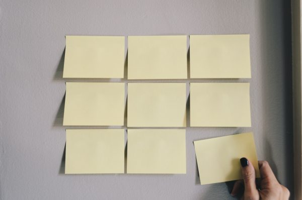 sticky notes plastered on a wall