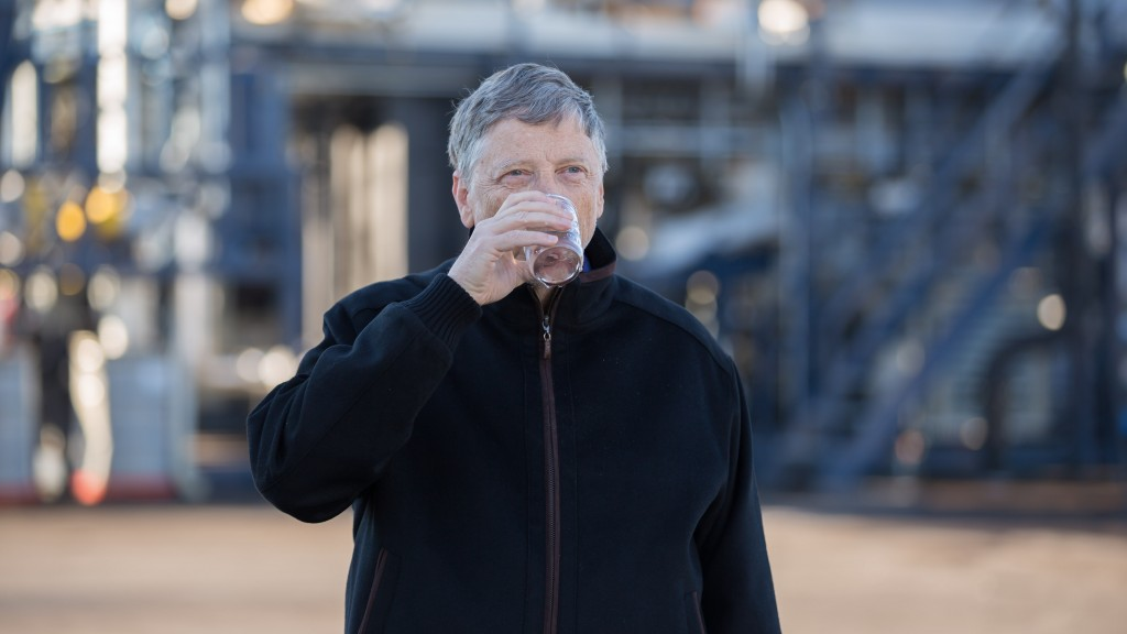 Bill Gates takes a sip of water