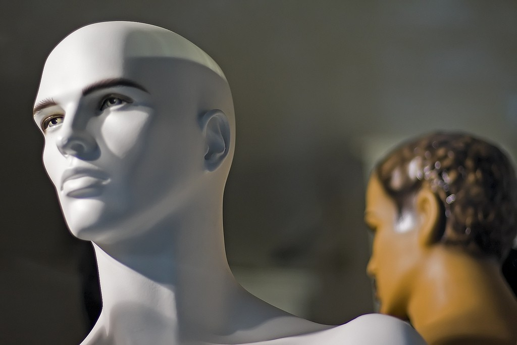 White male mannequin head in storefront window